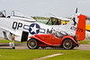 Vintage MG TA sportscar and P-51 Mustang fighter plane