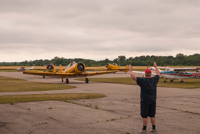 Shane Clayton marshals in the Harvards after their Canada Day flyovers at Port Burwell and Tillsonburg