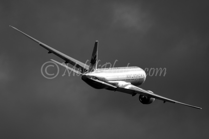 C-FIUA AC16 from VHHH missed approach RWY23 into wild clouds. (B&W version)