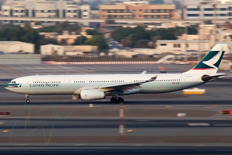 1/60 hand held panning shot of CX746 (B-HLP) as seen taking off RWY 30R on this beautiful late afternoon light.