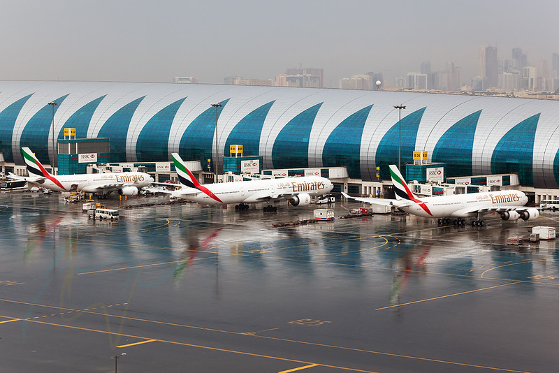 Yet another reflection in Dubai taken in a heavy shower which is obviously so rare. In the picture A6-ERA (EK133), A6-EBM (EK763) and A6-EAI (EK516) are seen getting ready for push back and their flight to DME (Moscow), JNB (Johannesburg) and DEL (New Delhi), respectively.