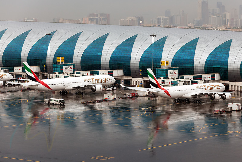 Yet another reflection in Dubai taken in a heavy shower which is obviously so rare. In the picture A6-ERA (EK133) and A6-EBM (EK763) are seen getting ready for push back and their flight to DME (Moscow) and JNB (Johannesburg), respectively.