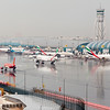 An overview of Dubai Airport on a rare rainy day. In the picture half of Terminal 3 (Emirates flights) and all of Terminal 1 (International, non-Emirates flights) can be seen.