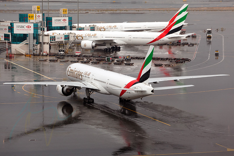 EK309 (A6-EBE) just arrived from PEK in a heavy shower.