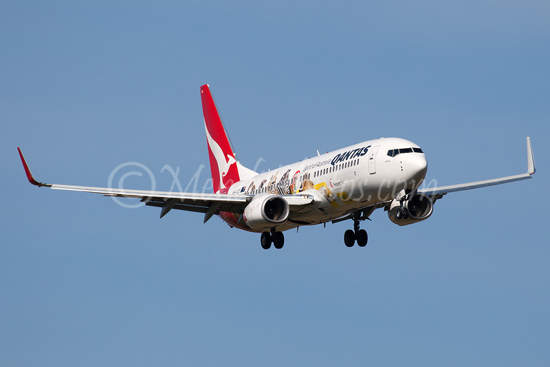New logo jet for Qantas celebrating their partnership in the Frequent Flyer Program with Optus. Arriving as QF 611 on RWY 34 from BNE