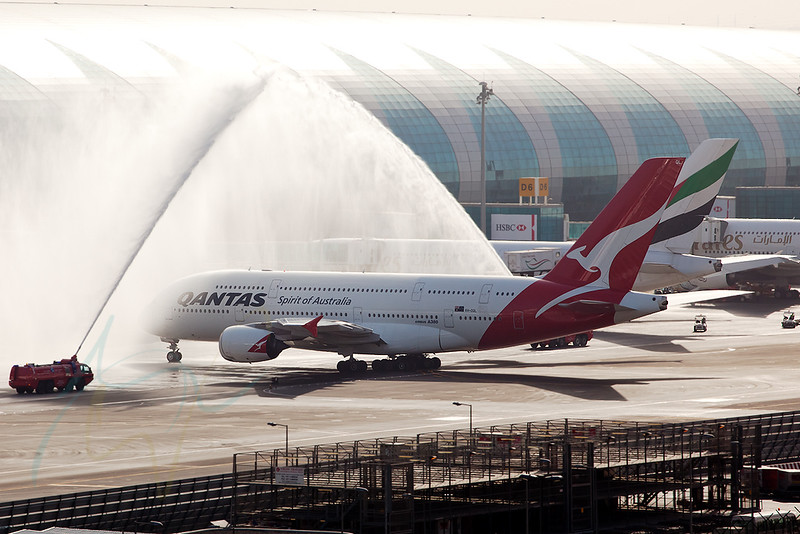 First Qantas arrival in Dubai in daylight (QF10, VH-OQL) get its water cannon salute at the newest Emirates Concourse A. QF10 just arrived from LHR and is leaving for MEL in two hours.