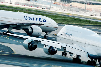 A pair of heavies ready for take-off at Frankfurt Airport.