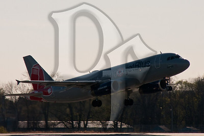 A JetBlue Airbus A320 in Boston Red Sox colors taking off from runway 4 at Rochester, NY (KROC)