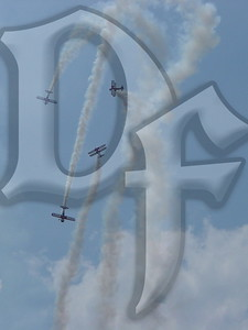 Four aircraft from the now disbanded Red Baron Squadron flight demonstration team perform a stall maneuver at the 2004 Rochester, NY International Air Show.