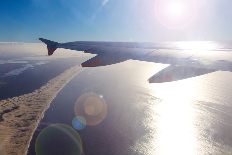 An early morning takeoff over Stockton Beach, Port Stephens. (NTL to MEL)