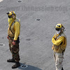 Aircraft Handling Officers/Plane Directors on board US Navy flight decks are distinguished by their yellow jerseys.