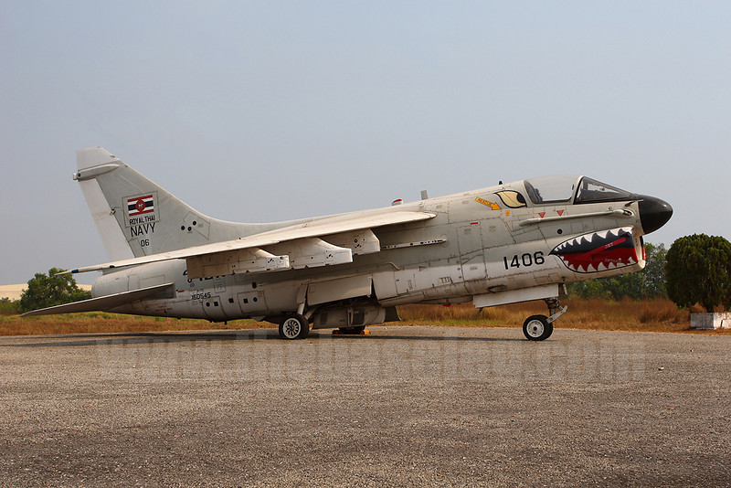 Royal Thai Navy A-7E Corsair II 1406/160545 with a more standard sharkmouth stored in the open at U-Tapao. The aircraft's ejection seat has been removed.