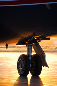 Dassault Falcon 2000 Right Main Landing Gear silhouetted by a fall sunrise in Lawrence, Kansas, USA.