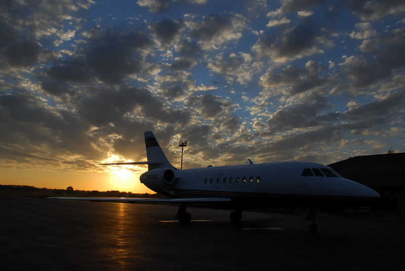 Dassault Falcon 2000 silhouetted by a fall sunrise in Lawrence, Kansas, USA.