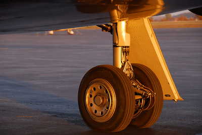 Dassault Falcon 2000 Right Main Landing Gear highlighted by a fall sunrise in Lawrence, Kansas, USA.