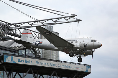 ex-USAF & Spanish Air Force Douglas C-47, 45-0951 / '5951', suspended from the top of the main Deutsches Technikmuseum building as a memorial to the Berlin Air Lift - 05/03/17.