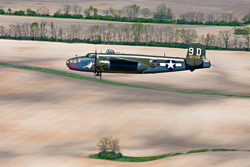"""""""Briefing Time"""" B-25 Mitchell in formation flight from the Air Force Museum honoring the Doolittle Raiders 2010."""
