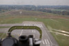 Photo taken October 16, 2008.  View from the bombardier's station crossing the approach end of Rwy 5R on takeoff from Rwy 23L at TYS.