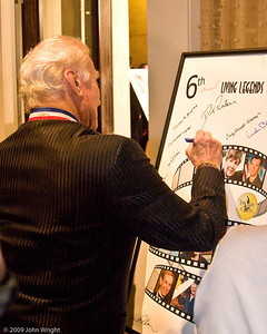 Dr. Buzz Aldrin signing the Legends poster