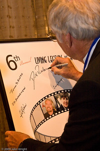 Dick Rutan signing the Legends poster