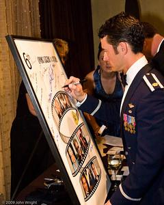 Major Paul Moga signs the Legends poster.