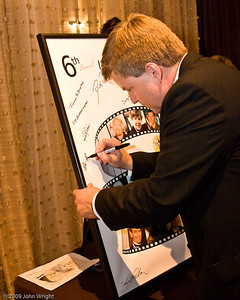 Alan Klapmeier signing the Legends poster
