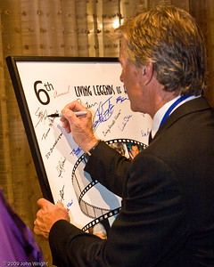 Sean Tucker signing the Legends poster
