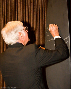 Dick Rutan signing the propeller