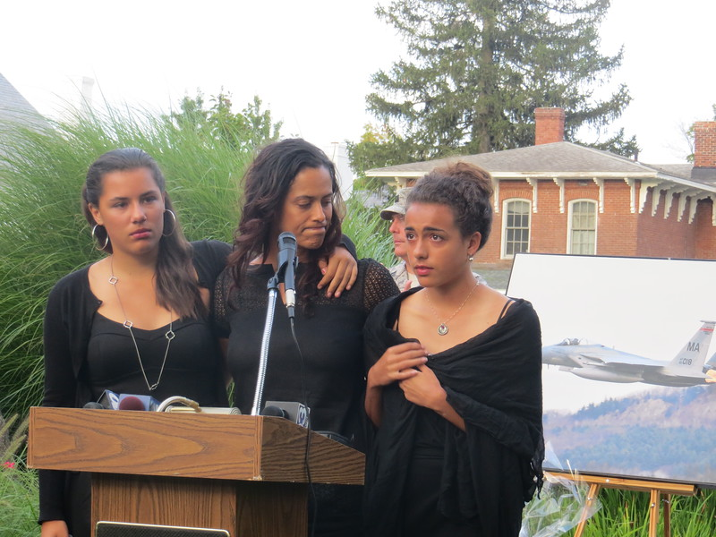 8-30-14   Fontenots in front of photo Kara purchased from me - memorial service in Longmeadow