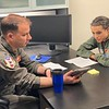 FB MooseCon 8 27 - 5 28 21 - photo 8 - TSgt Walter, 104th Fighter Wing Life Support, instructs Natalie in life support training
