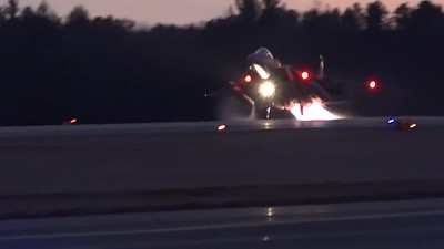 four F-15 Eagles taking off for night training
