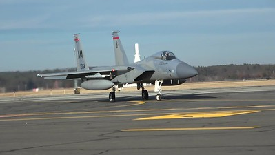 Two F-15s taxiing, departing, landing and taxiing back to base