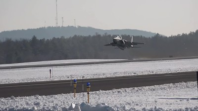 four F-15s taking off...2nd one vertical climb