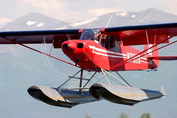 Piper Cub departing Lake Hood, Anchorage.