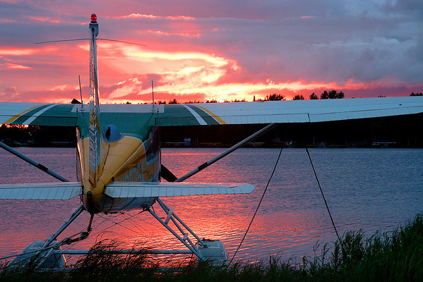 Cessna floatplane and sunset; Lake Hood, Anchorage.  Clouds and partially overcast skies can produce dramatic sunsets, as seen here.