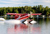 A turbine-powered deHavilland Otter starts its take off run on Lake Hood, Anchorage.