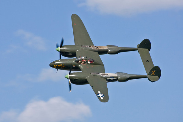 Lockheed P-38 Lightning against a beautiful summer sky.