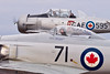 A close-up of Sawbones and the Harvard.  Both beautifully maintained aircraft sport Canadian maple leaf insignia.