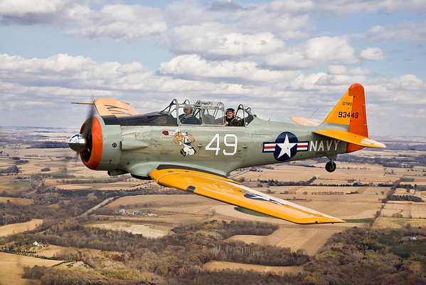 Photographer Max Haynes in the back seat of Bruce Olson's colorful SNJ during the day's first sortie.