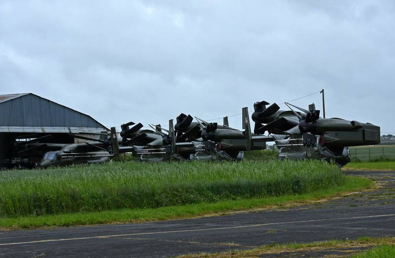 US Marine Corps Bell Boeing MV-22 Osprey tiltrotors, Carpiquet airport, Caen, 7 June 2019.  Visible from left are 12 (unfolded), 09, 06 & 10 (all folded).  These aircraft are part of the presidential entourage, but only carry support staff and equipment.