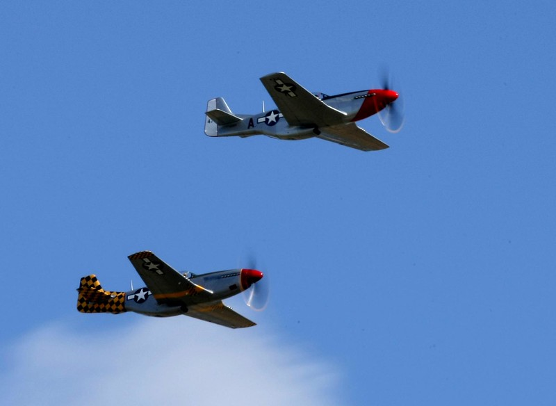 The North American Aviation P-51 Mustang was an American long-range single-seat fighter aircraft that entered service with Allied air forces in the middle years of World War II. The P-51 became one of the conflict's most successful and recognizable aircraft.