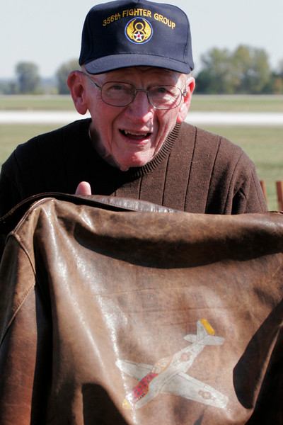"Eldon Troge with his original bomber jacket he wore when he flew during WWII. Flying 70 missions in P-51 Mustangs, P-47s and P-38s. 356 Fighter Group - 359 Fighter Squadron based at Martlesham Heath, Ipswich, England    <br /> <br /> <br /> <a href=""http://www.mhas.org.uk/"">http://www.mhas.org.uk/</a>"