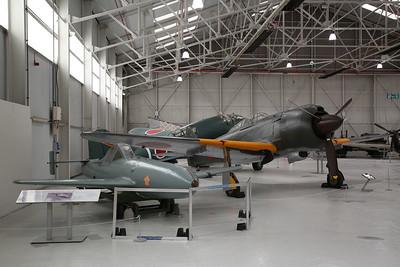 Yokosuka MXY7 Ohka 11 'Kamikaze' Single seat rocket powered suicide attack aircraft alongside sole-surviving ex-Japanese Army Air Force Kawasaki Ki-100-1b, 8476M / 16336, on display, RAF Museum, Cosford - 19/04/17.
