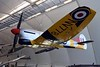 """Hawker Tempest TT.5 NV778, Royal Air Force Museum, Hendon, 10 September 2015.   Very successful fighter, introduced after the Typhoon.  This Mark 5 is painted for target towing. (""""We aim to please.  You aim too please!"""")"""