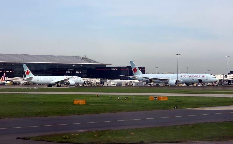 Air Canada Boeing 787-9 C-FGEO (left) & 777-300 C-FIVQ, Heathrow airport, Thurs 3 May 2018 - 1001.