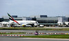 Unidentified Emirates Airbus A380, terminal 3, Heathrow airport, Tues 17 June 2014.  Photographed from inside terminal 4.