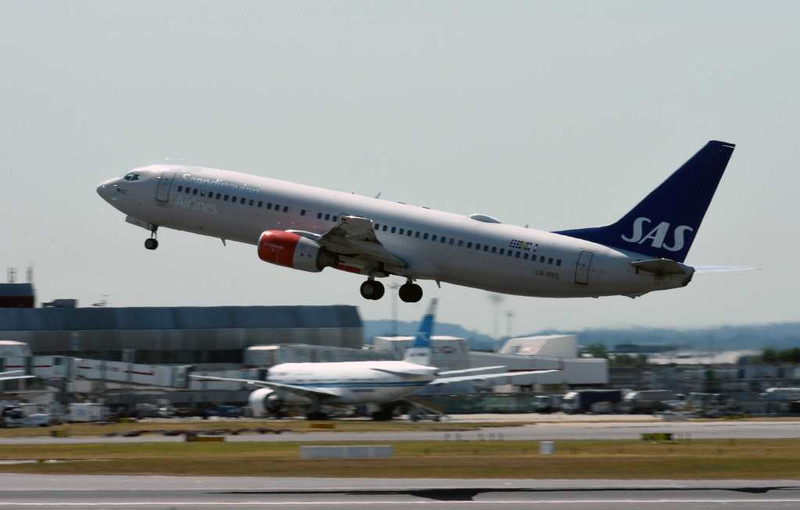 SAS Scandinavian Airlines Boeing 737-800 LN-RRS, Heathrow airport, Fri 3 July 2015 - 1106.  Photographed from inside terminal 3.
