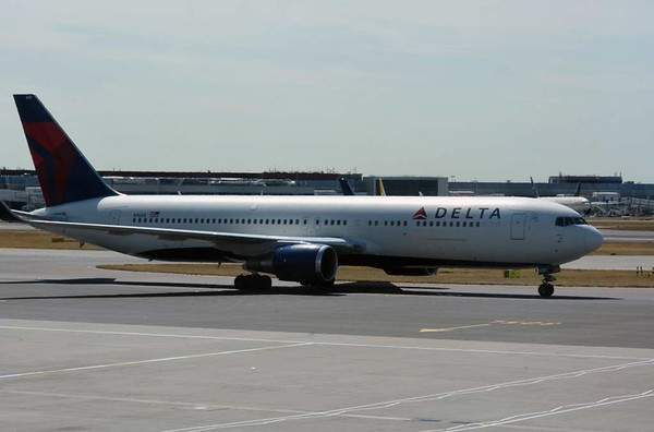 Delta Air Lines Boeing 767-300 N1608, Heathrow airport, Fri 3 July 2015 - 1100.  Photographed from inside terminal 3.
