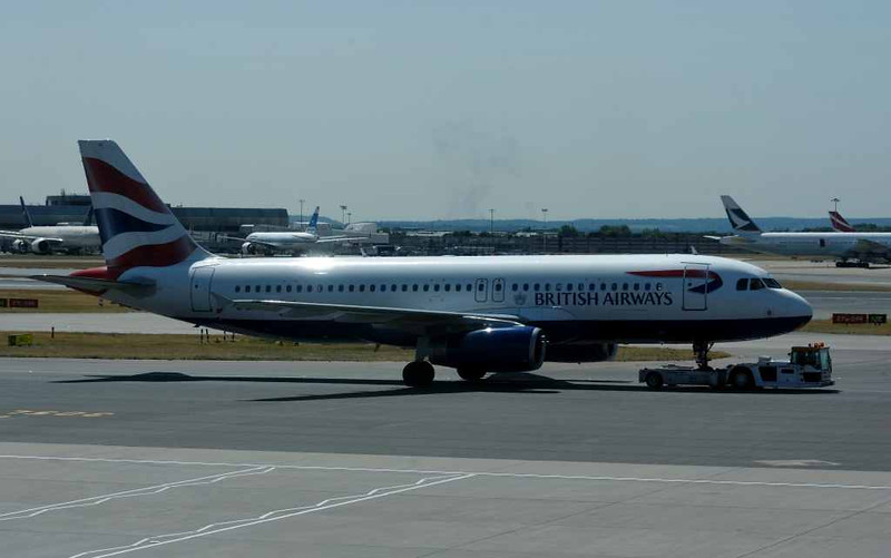 British Airways Airbus A320-200 G-EUUV, Heathrow airport, Fri 3 July 2015 - 1126.  Photographed from inside terminal 3.