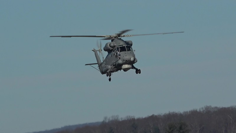 SH-2G Super Seasprite doing touch and gos and low approaches of two F-15s